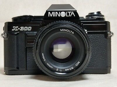 Black Minolta X-300 SLR film camera with 50mm lens