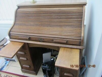 Due to home move we are selling this lovely oak roll top desk,
