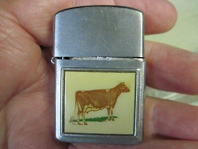 Vintage Pre-Owned Ritepoint Cigarette Lighter With Golden Guernsey Milk Products