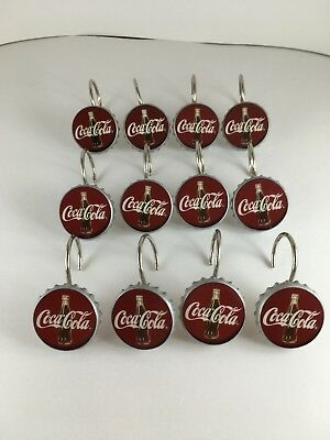 12 pc. lot Coca Cola Shower Curtain Holders i was told 1 3/4 wide.
