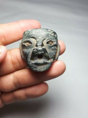 Pre-Columbian Olmec Mask pendant from Mexico. 400 bc.