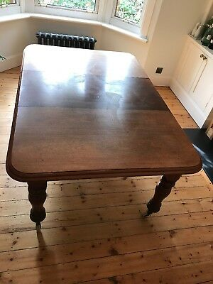 Antique Victorian C1900 mahogany wind out extending dining table with one leaf