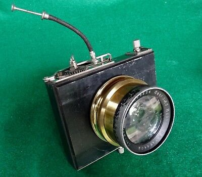 Carl Zeiss brass Jena 255mm f 6.3 lens in a Thornton-Pickard style cloth shutter