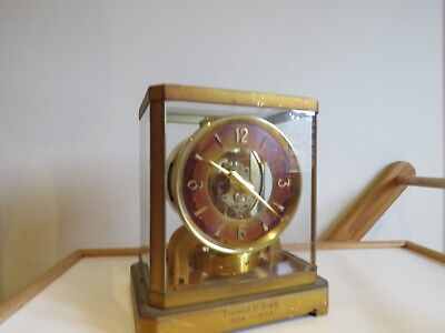 antique clock Atmos  with red face