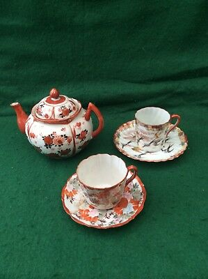 Antique Japanese tea pot and 2 cups and saucers