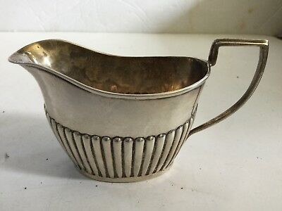 1800's Sterling Silver Ribbed Creamer John Jones III ?