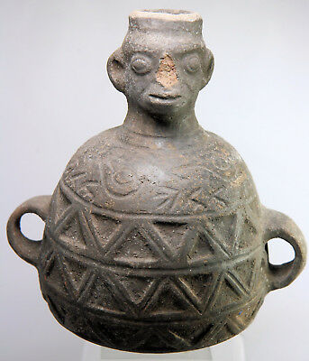 Ancient Pre-Columbian pottery vase with head and other decoration
