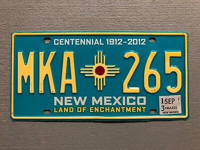 One New Mexico Turquoise Centennial Zia License Plate Random Letters/numbers