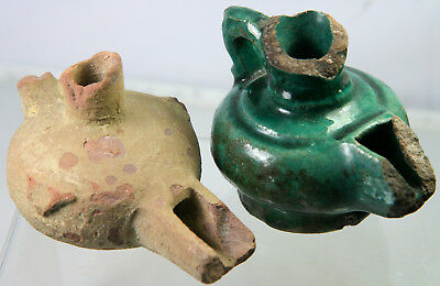 Two early Islamic glazed pottery oil lamps