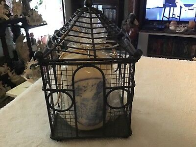 Blue willow pattern candle in decorative cage