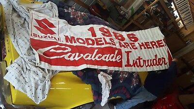 Vintage suzuki sign and 6 posters.