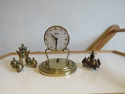 anniversary clock for parts and two a little pendulums for spares or repair