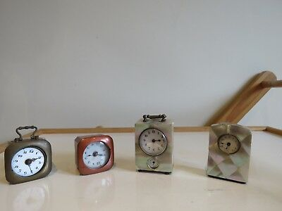 job lot of 4 a little clocks for parts