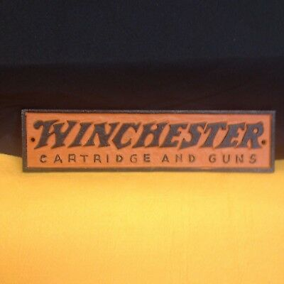 Cast Iron Winchester Sign