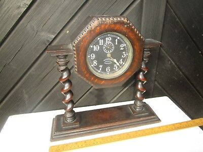 Antique WW1 era Ingersoll Revally Radiolite alarm clock with Oak mantel stand