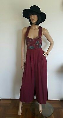 Vintage retro jumpsuit. Size 12. With cross over back straps. Maroon colour. H