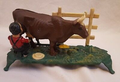 The Book of Knowledge Cast Iron Reproduction Antique Bank - Man Milking Cow