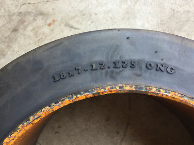 Brand new, press-on forklift tire 18 x 7 x 12 1/8 smooth