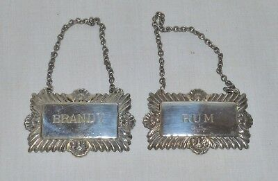 A pair of English Antique or Vintage silver plated decanter labels.