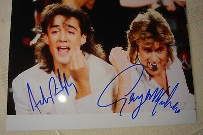 "WHAM! GEORGE MICHAEL, ANDREW RIDGELEY hand-signed 10"" x 8"" B&W photo with COA"
