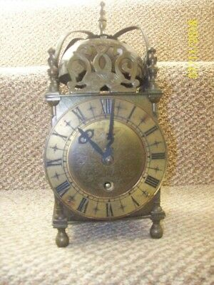 Lantern clock brass .Smiths with key.spare or repair.