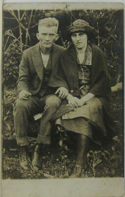 1910s 20s RPPC Rural Farm Man And Woman Seated On Log Postcard Americana