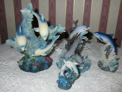 **collection Of Resin And Crystal Dolphin Figurines**