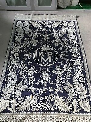 Antique blue and white woven bed throw featuring flowers, ferns and monogram