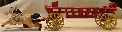Vintage cast iron fire wagon with two horses