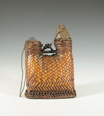 Fine Bontoc (Ifugao) rattan seed or lime container with wood stoppers