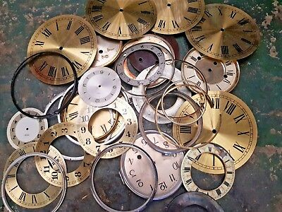 Collection of clock faces and Chapter rings for clock repairs