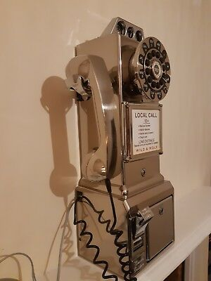 Vintage styled Chrome coloured plastic diner style wall phone