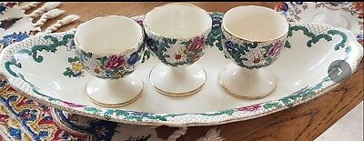 An interesting Royal Cauldon Victoria Plate with Three matching egg cups