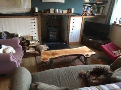 Unique rustic waney edged oak coffee table with victorian trestle legs