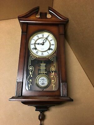 DELTA 31 DAY WIND UP CLOCK-WOOD CASE-WALL -LOOKS and WORKS GREAT