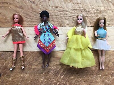 Topper Dawn Dolls--four dolls and all their groovy clothes