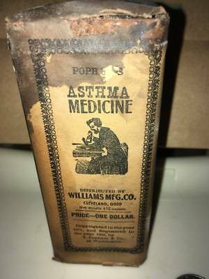 Antique Medicine tin Popham's Asthma Medicine with original paper wrapping Cleve