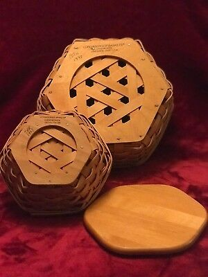 Lot of 2 Hexagon shaped signed Longaberger baskets. 98 & 97 with one lid.