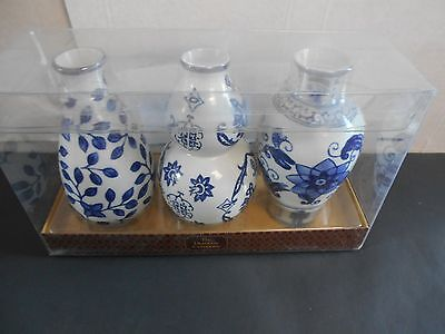 "Set of 3 Floral Ceramic Blue & White Vases.  Bombay. Vases are 3"" x 6"". Nice"