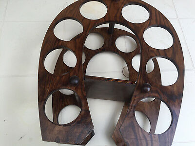 Wooden Wine Rack Used but in good condition and holds up to 8 bottles