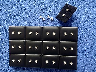 JOB LOT-12 pairs of 0.45cm crystal diamante stud earrings.Silver plated.UK made.