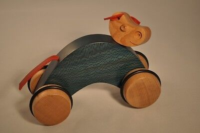 Cow Baby green pull toy in solid Wood Green ecological birth gift made in France
