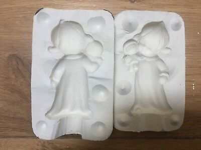 CERAMIC OR PORCELAIN SLIP CASTING MOULD OF A 3 inch LITTLE GIRL WITH DOLL.