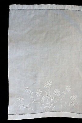 Vintage white hand towel/cloth with white embroidered flowers.
