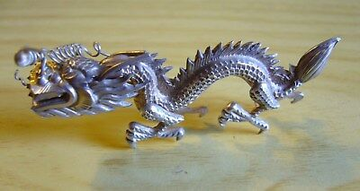 "Antique Chinese Dragon, 2.25"" by 1""."
