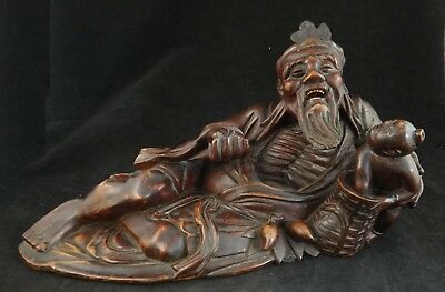 "Vintage Chinese Hand Carved Rosewood Reclining Figure, 13 ½"" L.  1st ½ 20th c."