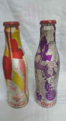 Coca cola bottles aluminum lovebeing and lobo M5 brazil, empty