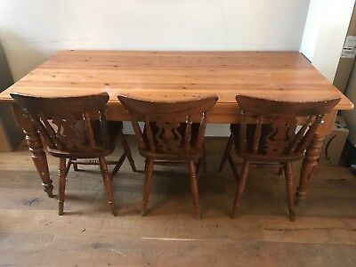large pine farmhouse table to seat 6-8 with 3 matching chairs