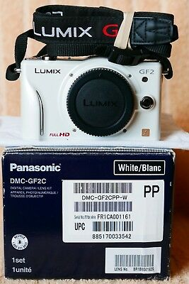 Panasonic GF2 12.1MP d/cam,boxed w/full line accessories,mint working condition.