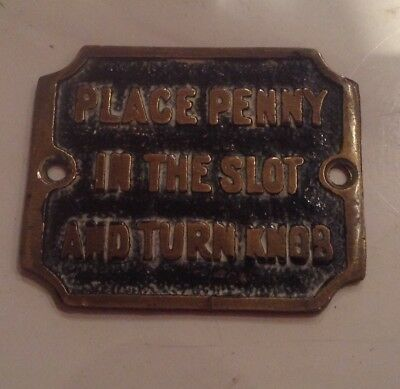 Antique,brass Plaque,sign.place Penny In Slot And Turn Knob